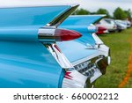 """Small photo of PAAREN IM GLIEN, GERMANY - JUNE 03, 2017: Rear stoplights of a full-size luxury car Cadillac Coupe DeVille, 1959 (focus in the foreground) Exhibition """"Die Oldtimer Show""""."""
