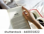 Woman reading book novel on bed ...
