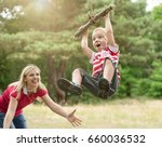 little boy riding on a... | Shutterstock . vector #660036532