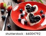 two toast hearts with fresh bilberry jam - stock photo