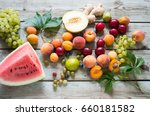 fruits on a wooden background | Shutterstock . vector #660181582