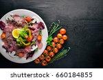 carpaccio of beef  vegetables ...   Shutterstock . vector #660184855