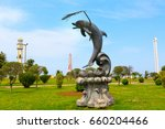 Small photo of Batumi, Georgia - May 2, 2017: City panoramic landscape with Ch acha tower, ferris wheel and dolphin statue in Batumi, Georgia summer Black sea resort
