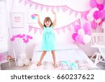 cute girl standing on bed at... | Shutterstock . vector #660237622