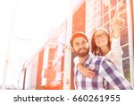 smiling woman pointing away... | Shutterstock . vector #660261955