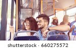 smiling young couple in a bus. | Shutterstock . vector #660275572
