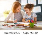 mother and child daughter draws ... | Shutterstock . vector #660275842
