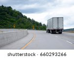 Small photo of The way of transporting and delivering goods in America is reliable road transport with help of professional semi trucks with capacious and safe semi trailers on developed network of American roads