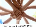 young people putting hands... | Shutterstock . vector #660329716