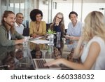 smiling business people sitting ... | Shutterstock . vector #660338032