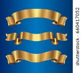 set of golden ribbons on blue... | Shutterstock .eps vector #660417052
