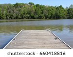 the wood dock at the lake  | Shutterstock . vector #660418816