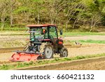 Red Tractor In The Field.
