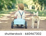 Stock photo boy playing with his dog outdoors enjoying together 660467302