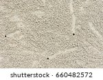 Small photo of Pattern of Sand bubble crab or Scopimera or Dotilla on the beach background texture