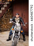 the biker and his dog are... | Shutterstock . vector #660487792