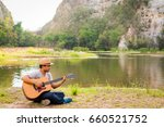 young man playing guitar on... | Shutterstock . vector #660521752