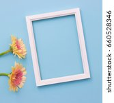 photo frame and yellow flower...   Shutterstock . vector #660528346