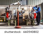 man and robotic machine work... | Shutterstock . vector #660540802