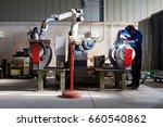 man and robotic machine work... | Shutterstock . vector #660540862