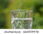 pour mineral water into a glass | Shutterstock . vector #660559978