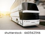 modern tourist bus on asphalt... | Shutterstock . vector #660562546