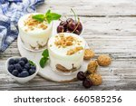 healthy summer dessert of berry ... | Shutterstock . vector #660585256
