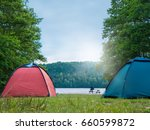 Campsite With Tents At A Lake ...