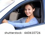 beautiful woman driver smiling... | Shutterstock . vector #660610726