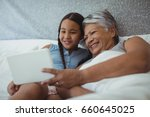 grandmother and granddaughter... | Shutterstock . vector #660645025