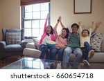 smiling family watching... | Shutterstock . vector #660654718
