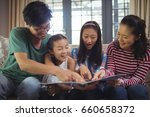 family watching photo album... | Shutterstock . vector #660658372