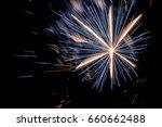 sparkling firework on night... | Shutterstock . vector #660662488
