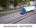 a blue semi truck with day... | Shutterstock . vector #660736585