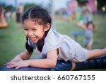 kids playing on a playground   Shutterstock . vector #660767155
