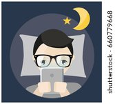 man using tablet before bed...   Shutterstock .eps vector #660779668