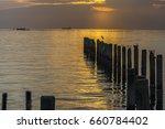 ocean sunset with orange sky... | Shutterstock . vector #660784402