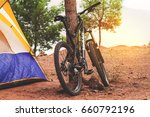 a mountain bike and a tent in... | Shutterstock . vector #660792196