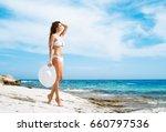 beautiful woman in white bikini.... | Shutterstock . vector #660797536