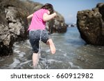 young girl playing in the sea...   Shutterstock . vector #660912982