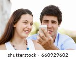 young couple in the park | Shutterstock . vector #660929602
