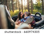 a happy young couple kissing in ... | Shutterstock . vector #660974305