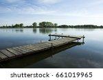 bridge on the lake | Shutterstock . vector #661019965