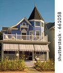 This is a shot of a purple victorian home located in a shore town in New Jersey. - stock photo