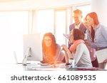 smiling businesspeople working... | Shutterstock . vector #661089535