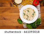 chicken alfredo pasta with... | Shutterstock . vector #661093018