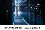 it technician works on laptop... | Shutterstock . vector #661115515