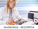 young woman fix pc component in ... | Shutterstock . vector #661140916