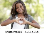 Girl making a heart shape - stock photo