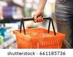 men's hand holding an empty... | Shutterstock . vector #661185736